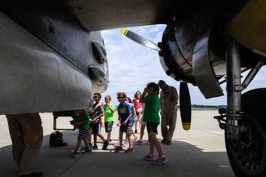 Kids attending the Children Museum of Evansville summer camp explore vintage aircraft during tour at Tri-State Aero Friday, June 21,2019. The air show won't be happening this year according to officials and they are planning on a revised festival in 2021.