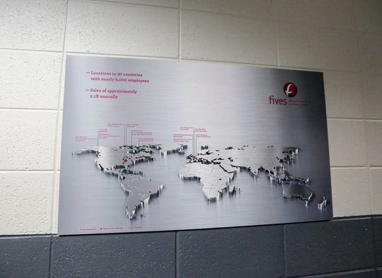 A display shows where Fives businesses are located in the world on June 20, 2019 in Fond du Lac, Wis.