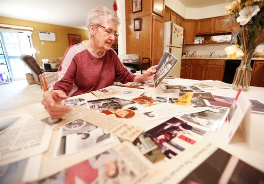 Judy Goldsmith, of Fond du Lac, looks at her collection of photos and newspaper clippings from her career as a national leader of the women's rights movement on Friday, June 21, 2019, in her Fond du Lac, Wis. home.