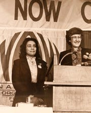 Coretta Scott King stands next to Judy Goldsmith as she speaks at a National Organization for Women (NOW)  convention in Washington, D.C., in this 1983 photo.