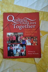 """Popular local author Krista Michaels recently published her newest book, """"Quilting Our Lives Together,"""" a pictorial history of a local quilting group and its impact on the community."""