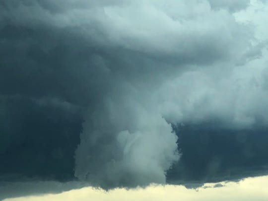 This funnel cloud formed near Vine Drive and Interstate 25 late Tuesday afternoon.