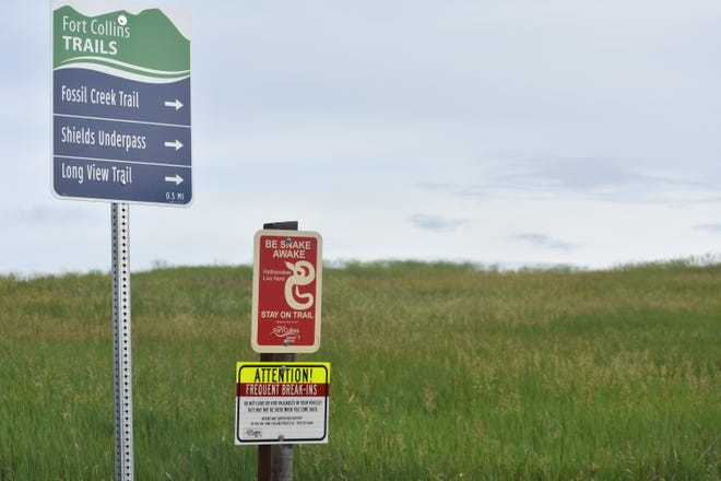 A sign at the Cathy Fromme Prairie Natural Area in south Fort Collins warns visitors of vehicle break-ins and rattlesnakes.
