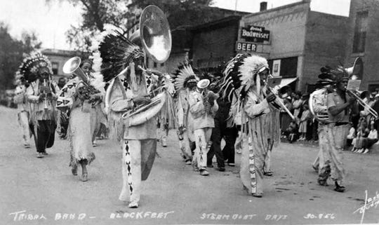 The Blackfeet Tribal Band plays while marching down Front Street in Fort Benton during Steam Boat Days in late June of 1937.