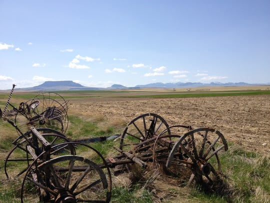 Old farm equipment still marks the land that Hank Armstrong's father and grandfather homesteaded in sight of Square Butte about seven miles east of Geraldine.