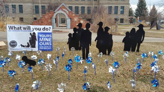 A pinwheel display in front of Paris Gibson Square in support of the responsibility campaign Yours, Mine, Ours: Let's Unite to Keep Kids Safe.