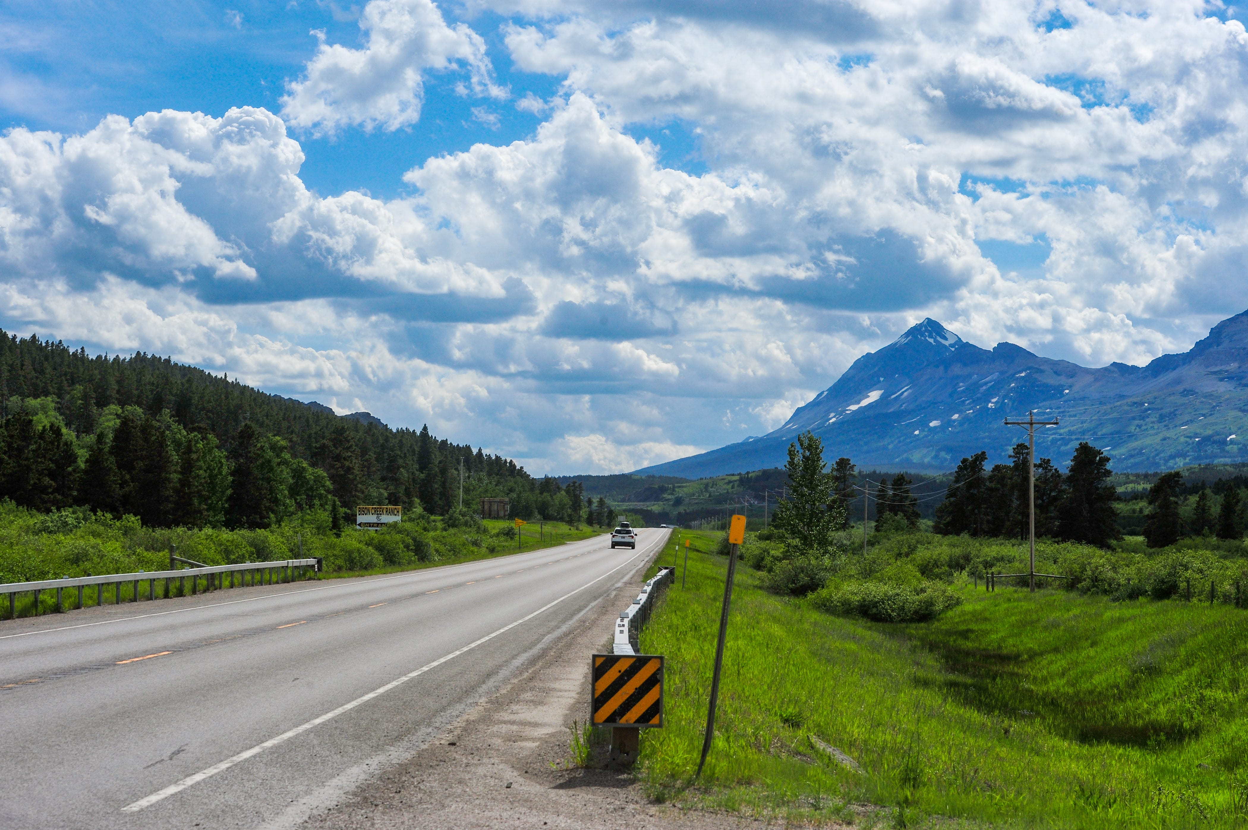 U.S. Highway 2 travels west along the southern border of Glacier National Park connecting the two sides of the park.   A major travel route for local and tourist traffic it also serves as a main evacution route during wildfires.