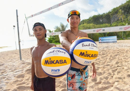Team Guam's beach volleyball representatives for the upcoming Pacific Games, Zakhary Zacarias, 25, left, and Brian Tsujii, 23, at Gun Beach in Tumon June 21.