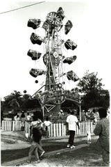 Many rides, including the Zipper, attract fun seekers of all ages at the Liberation Day carnival at Ypao Beach Park. Photo taken on June 29, 1991.