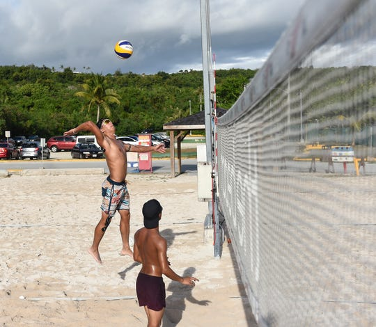 Team Guam beach volleyball player Brian Tsujii jumps to spike the ball during a practice at Gun Beach in Tumon, June 21.