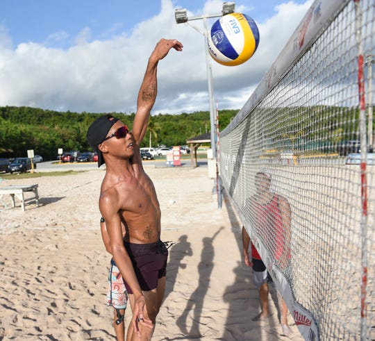 Team Guam beach volleyball player Zakhary Zacarias runs through a drill during practice at Gun Beach in Tumon, June 21.