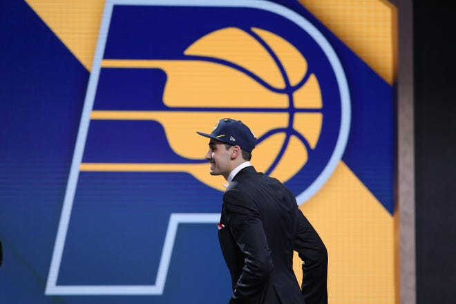 Jun 20, 2019; Brooklyn, NY, USA; Goga Bitadze (Georgia) walks onto the stage after being selected as the number eighteenth overall pick to the Indiana Pacers in the first round of the 2019 NBA Draft at Barclays Center. Mandatory Credit: Brad Penner-USA TODAY Sports
