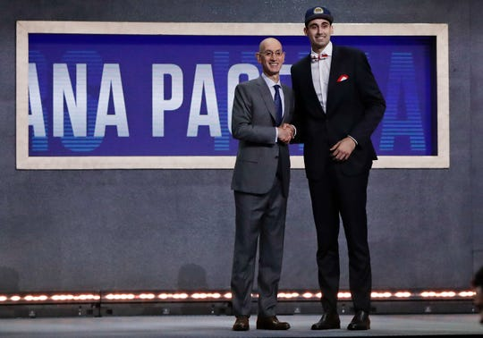 NBA Commissioner Adam Silver poses for photographs with Goga Bitadze, from Georgia, after the Indiana Pacers selected him as the 18th overall pick in the NBA basketball draft Thursday, June 20, 2019, in New York. (AP Photo/Julio Cortez)
