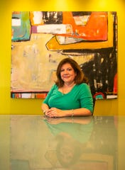 Kathy Cabello poses for a photo in her Indianapolis office, Tuesday, June 18, 2019.