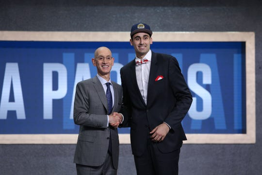 Jun 20, 2019; Brooklyn, NY, USA; Goga Bitadze (Georgia) greets NBA commissioner Adam Silver after being selected as the number eighteenth overall pick to the Indiana Pacers in the first round of the 2019 NBA Draft at Barclays Center.