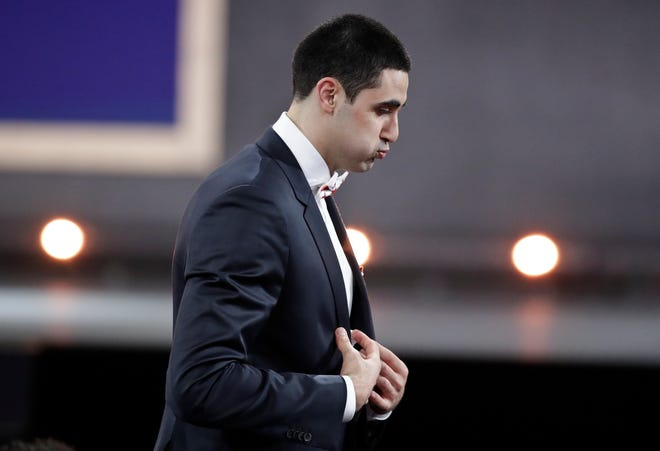 Goga Bitadze, from Georgia, reacts after the Indiana Pacers selected him as the 18th overall pick in the NBA basketball draft Thursday, June 20, 2019, in New York. (AP Photo/Julio Cortez)