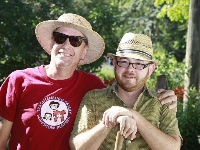 """Jeff Ayers, left, is pictured with Dave Frohbieter in 2011. The men transformed a neighborhood eyesore into a vegetables and flowers patch they called """"Squatter's Garden."""""""