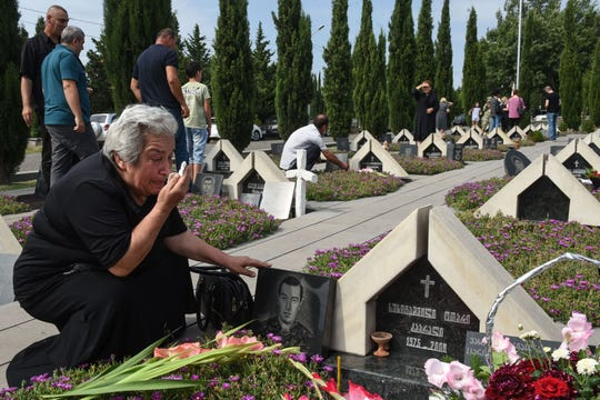 Relatives of Georgia's servicemen killed during the 2008 brief war with Russia over control of South Ossetia mourned during a ceremony on the 10th anniversary of the conflict at the memorial cemetery in Tbilisi on Aug. 8, 2018.