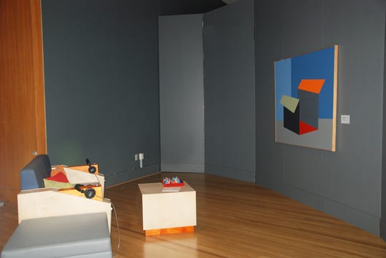 Visitors can sit and view Hines' art while getting tips on how to digest abstract art through their headphones.