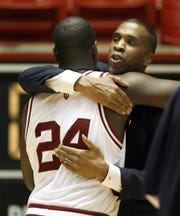 IU's Mike Davis and Robert Vaden hug after beating San Diego State in the first round of the NCAA tournament in Salt Lake City in 2006.