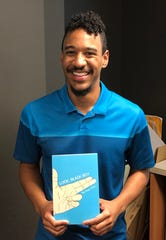 "Caleb ""The Negro Artist"" Rainey with his debut book ""Look, Black Boy"""