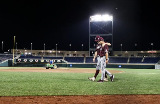 Mississippi State senior pitcher Cole Gordon walks off the mound for the final time in his collegiate career. Hitting coach Jake Gautreau was with him every step of the way.