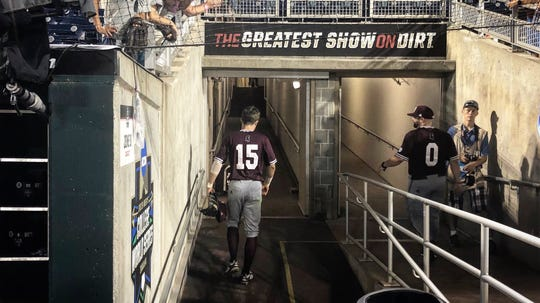 Mississippi State senior Jake Mangum walks out of the dugout for the final time as a Bulldog. His career came crashing to an end in heartbreaking fashion.