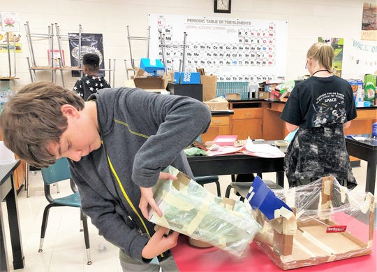 """Rising seventh grader Emmett Campbell works on his Mission to Mars colony. """"I knew right away what I wanted to do. I needed to add a greenhouse to convert carbon dioxide and an aquifer that would pump water from underground,"""" said Campbell of the project he worked on with Eliana Edmonson and Ryker McCullock."""