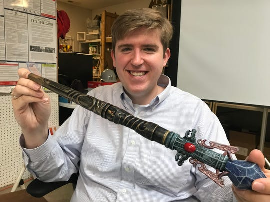 "Matt Cross, CEO of Boyd Hollow Resorts,  holds an the RFID-chip ""wand"" as a sample of the technology which Ancient Lore Village guests are intended to use as personalized storytelling keys. Ancient Lore guests will get an upgradable ""orb"" at check-in with similar interactive technology."