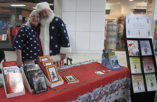 Joe and Mary Moore at the Foothills Mall in Maryville, Tenn. where they will be signing books again this year for a Christmas in July special event.