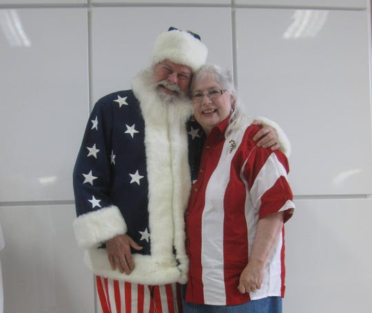 Professional Santa Claus and author Joe Moore with his wife and illustrator Mary Moore work to produce versatile books for every age.
