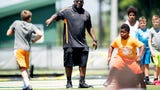 Youth players participate in the Legends of Tennessee football camp on Friday in Kodak.