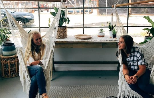 Co-founders Jess Vossler and Hannah Collins Lee in the Second Mile office on Sevier Avenue, adjacent to Honeybee Coffee.