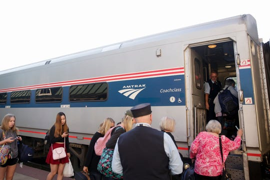 Passengers board the 851 Hoosier State to Chicago, Friday, June 21, 2019 in Lafayette.