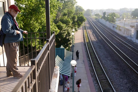 Joe Krause looks towards the Big Dour Depot for passengers as he waits for the arrival of the 851 Hoosier State, Friday, June 21, 2019 in Lafayette. Krause, a retired West Lafayette High School teacher has been volunteering since 2000. On June 30th, the Hoosier State Trains will be taken out of service due to lack of funding from the state of Indiana.