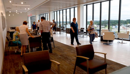 People walk through a waiting area of the Fairfield Medical Center River Valley Campus Thursday evening, June 21, 2019, in Lancaster. An open house was hosted at the new 95,000 sq. ft. building.