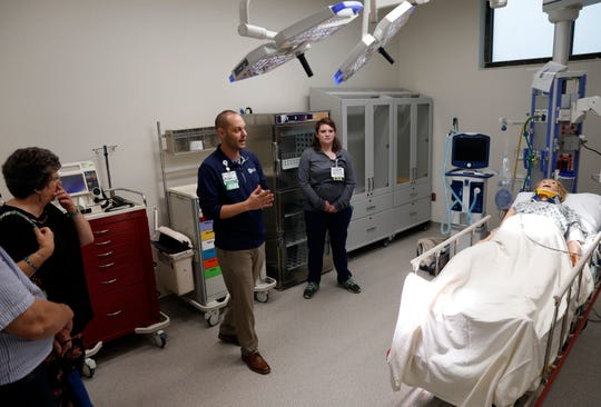 People visit the trauma room at Fairfield Medical Center River Valley Campus Thursday evening, June 20, 2019, during a tour of the new facility in Lancaster.
