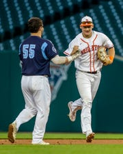 Bobby Cavin (55) of Livonia Stevenson congratulates Brighton's Jack Krause after a great catch in right field during the East-West All-Star Classic at Comerica Park on Thursday, June 20, 2019.