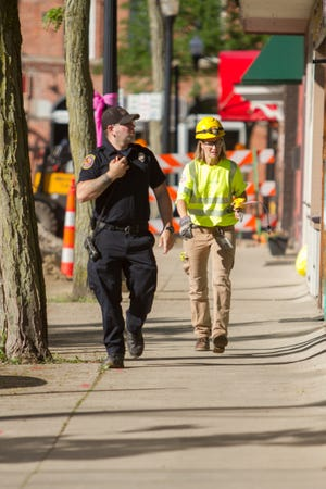 Howell Area Fire Dept. and Consumers Energy personnel investigate a gas leak which originated in the alley between Michigan Ave., State St. and Clinton St. in downtown Howell Friday, June 21, 2019.