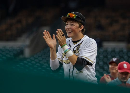 Howell's Luke Russo cheers from the Detroit Tigers' dugout during the East-West All-Star Classic at Comerica Park on Thursday, June 20, 2019.