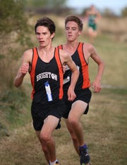 Brighton's Zach Stewart (front) and Jack Spamer each broke the school cross country record and made all-state.