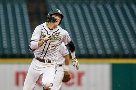 Howell's Luke Russo heads for third base after his single to left field was misplayed during the East-West All-Star Classic at Comerica Park on Thursday, June 20, 2019.