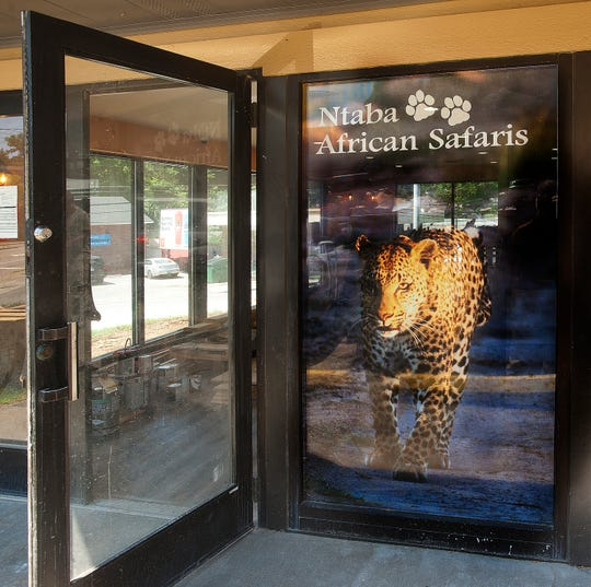 The front door to the Ntaba Coffee Haus sports a photograph of a leopard that the cafe's owner, South African native Robin Mountain photographed on safari. Mountain has been booking tours to Africa for the past 15 years, and  will now do so from his beanery on Brownsboro Road in Louisville. 21 June 2019