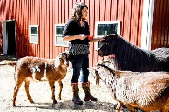 Danielle Raad tends to the animals on Monday, April 15, 2019 at Fanciful Farming in Eaton Rapids.