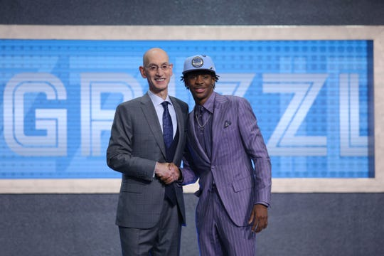 Ja Morant greets NBA commissioner Adam Silver after being selected as the number two overall pick for the Memphis Grizzlies in the first round of the 2019 NBA Draft at Barclays Center.
