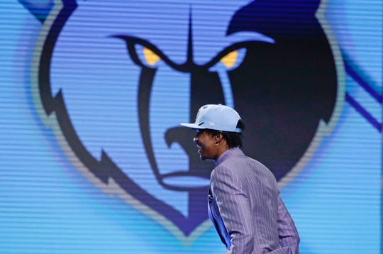 Murray State's Ja Morant walks on stage after being selected with the second pick overall by the Grizzlies on Thursday.