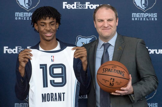 June 21, 2019 - Memphis Grizzlies guard Ja Morant (center) poses for a photo with head coach Taylor Jenkins during a press conference at FedExForum. The Grizzlies chose Morant with the second overall pick in the 2019 NBA Draft.