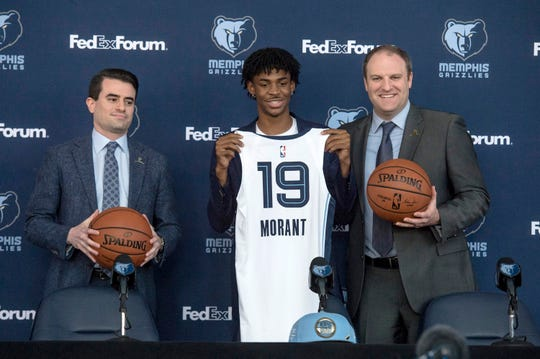June 21, 2019 - Memphis Grizzlies guard Ja Morant (center) poses for a photo with executive vice president of basketball operations Zach Kleiman (left) and head coach Taylor Jenkins during a press conference at FedExForum. The Grizzlies chose Morant with the second overall pick in the 2019 NBA Draft.