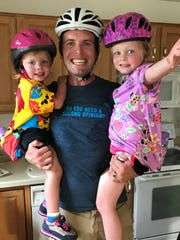 Nick Reistad, co-owner of Raised Grain Brewing Co. in Waukesha, is a retired professional cyclist. His oldest child, Chloe, 6, is going to be in her first bike race June 23.