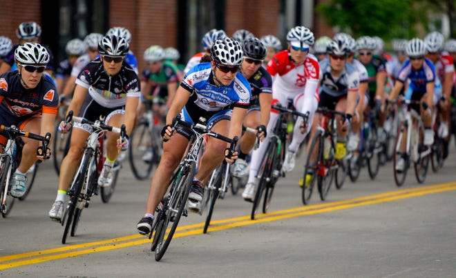 Cyclists race down N. Oakland Ave. in Shorewood during the opening night of the Tour of America's Dairyland in 2011.